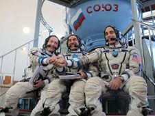 At the Gagarin Cosmonaut Training<br /> Center in Star City, Russia,<br /> Expedition 35 Flight Engineers Chris<br /> Cassidy (right), Pavel Vinogradov<br /> (center) and Alexander Misurkin clasp<br /> hands for photographers.<br /> Credit: NASA TV